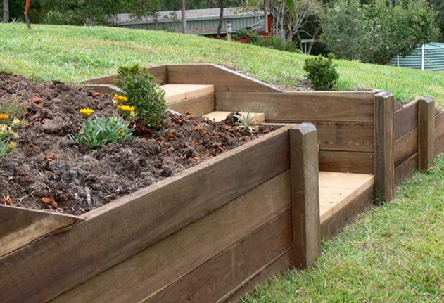 Retaining walls amber leaf landscaping sunshine coast for Wooden garden wall ideas